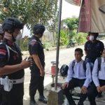 Personil Batalyon C Pelopor Lakukan Patroli dan sosialisasi COVID-19