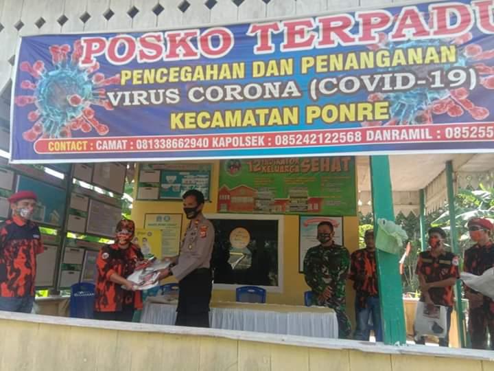 Kapolsek Ponre Hadiri penyerahan APD dari MPC Pemuda Pancasila di Posko Terpadu